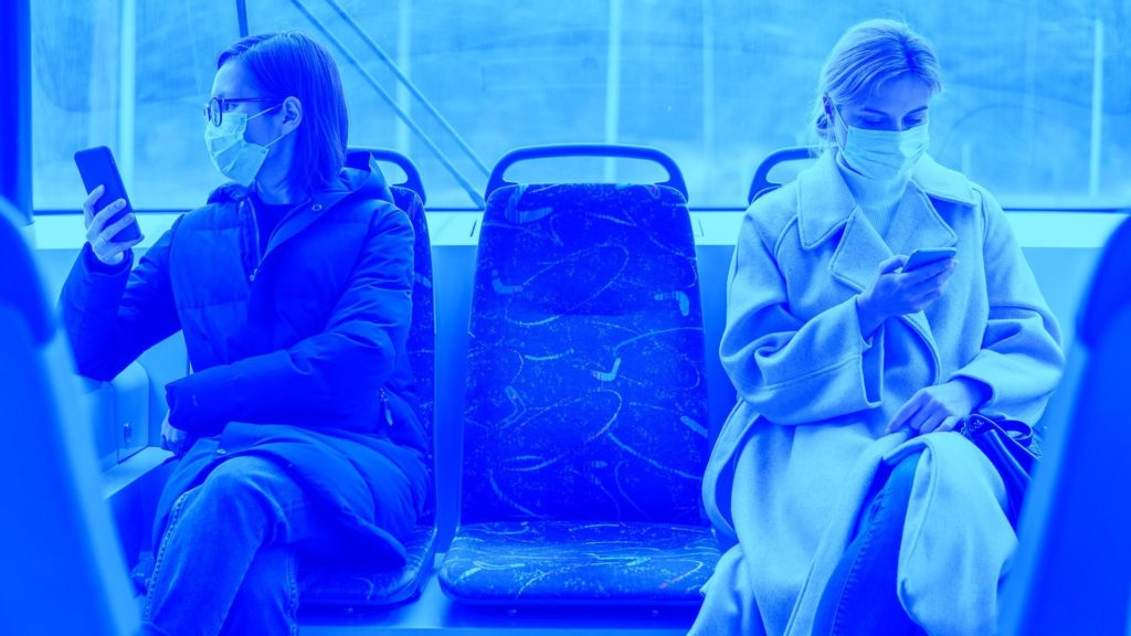 covid-19 - Masked people respecting social distancing on public transport due to pandemic